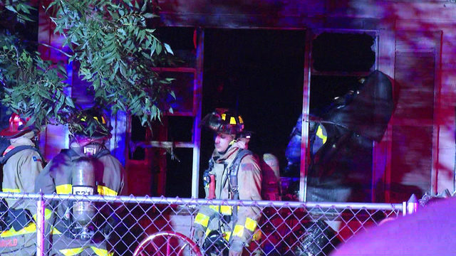 Firefighters keeping watch on South Side home after fire rekindles