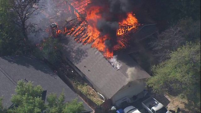 SAFD: 1 person treated for smoke inhalation as crews battle major house fire