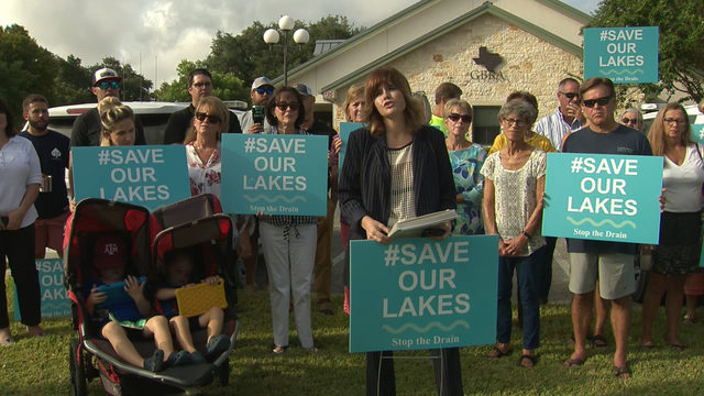 Protesters gather to stop draining of 4 area lakes