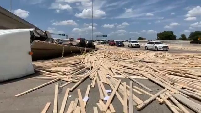Wooden boards spill onto roadway in 18-wheeler rollover; part of I-10 shut down
