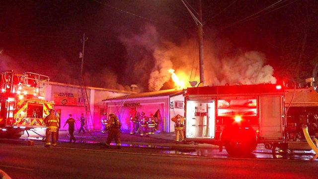 Heavy flames, smoke, damage South Side print shop