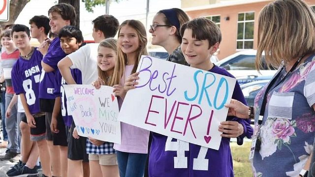 Students line streets to welcome home injured Boerne police officer