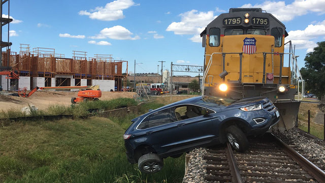 'Never a good idea to stop on train tracks:' Train collides with car in…