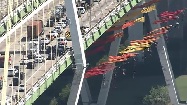 Greenpeace activists suspended from bridge at Houston Ship Channel