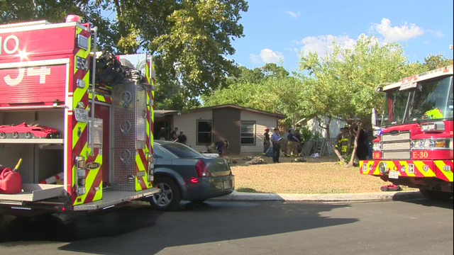 San Antonio firefighters rescue woman from burning East Side home