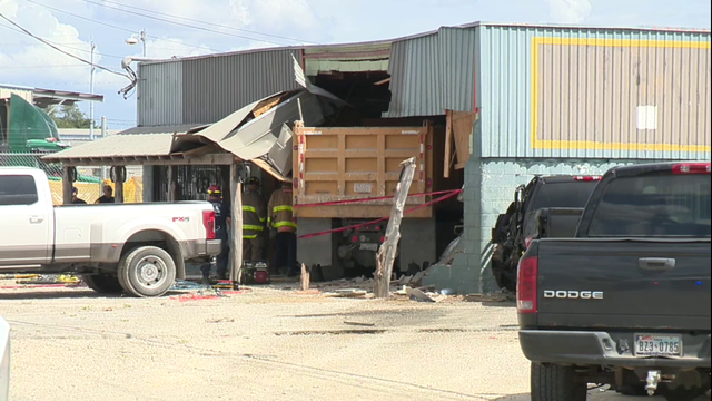 WATCH LIVE: Dump truck crashes into building on East Side