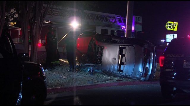 Firefighters rescue woman in rollover crash
