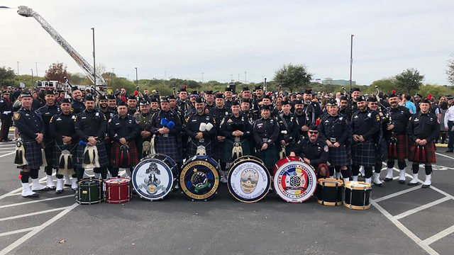 SAPD'S pipe and drum band perform at funeral for Harris County deputy