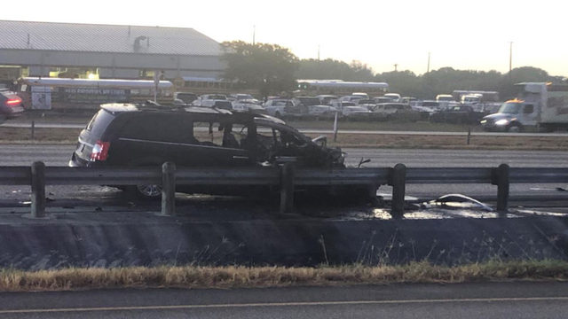 Van catches fire after hitting truck; driver unharmed, police say