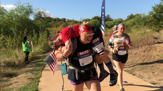 More than 2,000 people test their strength to honor wounded veterans