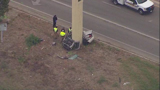 1 killed in crash that left car wrapped around concrete pillar on North Side