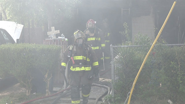 Four people escape house fire; front of home a complete loss