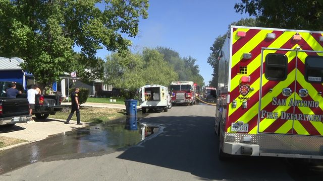 Crews work to determine cause of West Side house fire
