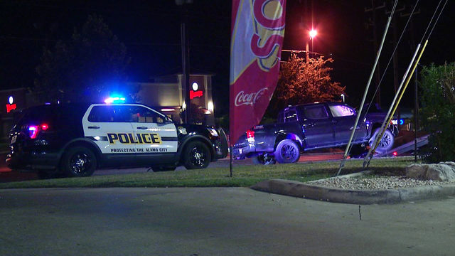 Woman pinned inside car during crash with pickup truck, police say